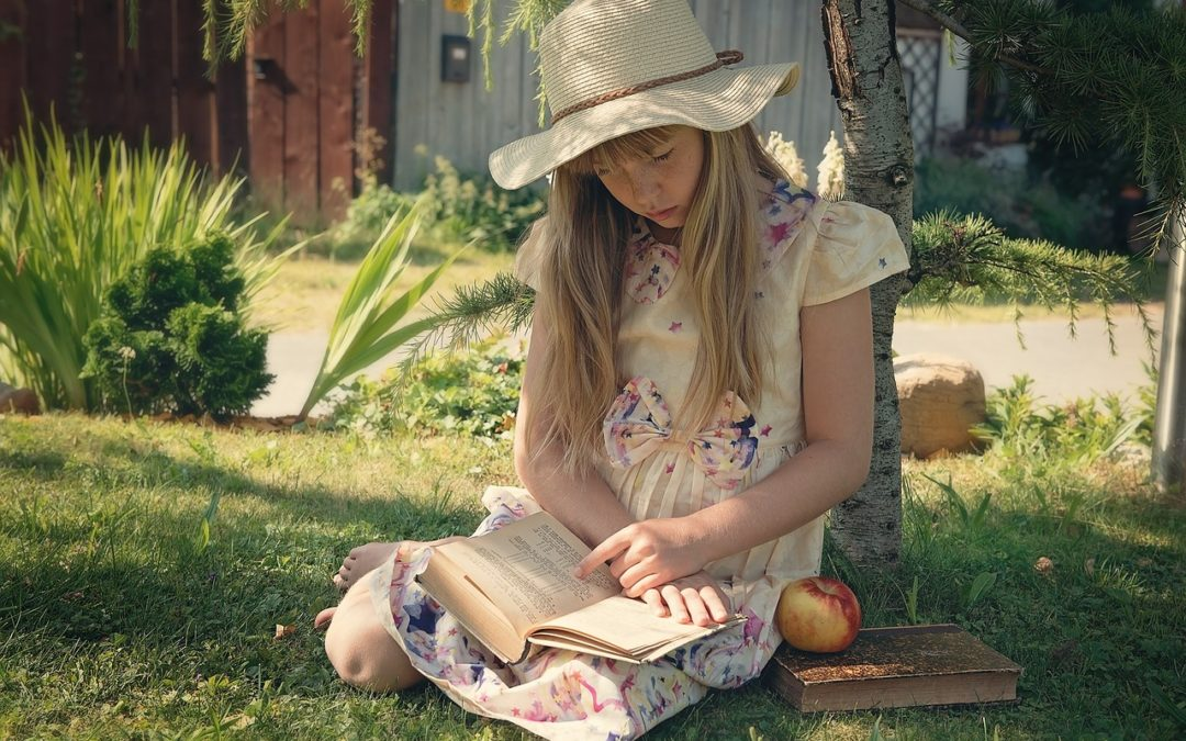 girl-sitting-in-the-garden-with-a-book-on-her-lap